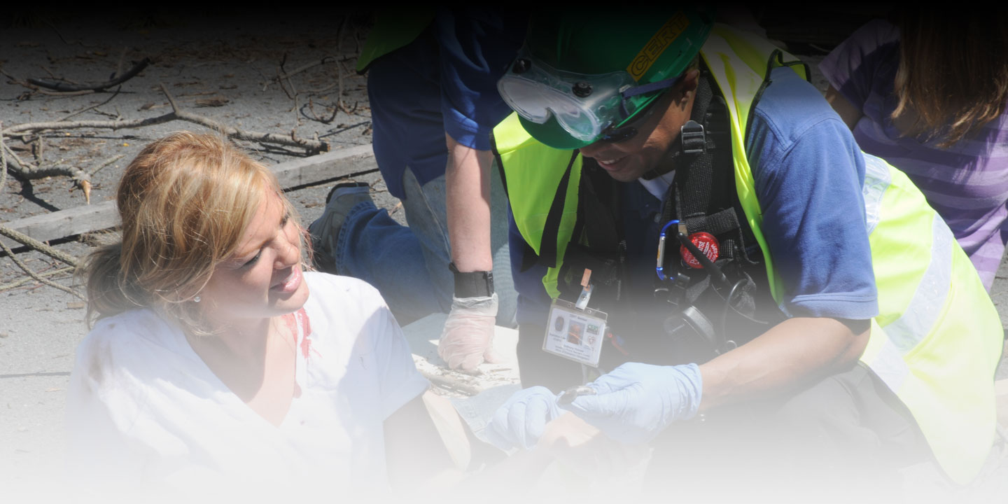 A member of the Community Emergency Response Team assists an injured woman